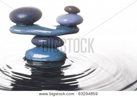 Carefully balanced stones in water