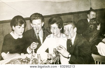 LODZ, POLAND CIRCA 1950's: Vintage photo of young people enjoying a party in restaurant