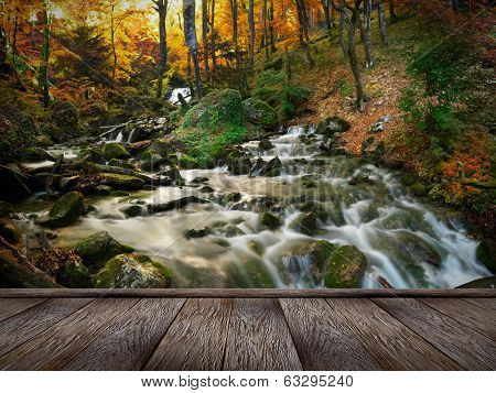 Autumn creek woods with yellow trees foliage and rocks in forest mountain and wood pier