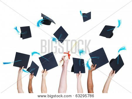 Group of Graduating Student's Hands Holding and Throwing Graduation hats as a Sign of Celebration
