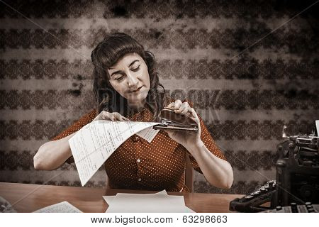 Young Woman With Red Dress Stapling Papers In Office, 1960's