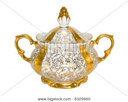Porcelain sugar bowl from an old antique tea-set on a white