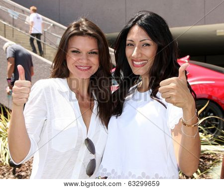 LOS ANGELES - APR 12:  Danielle Vasinova, Saye Yabandeh at the Long Beach Grand Prix Pro/Celeb Race Day at the Long Beach Grand Prix Race Circuit on April 12, 2014 in Long Beach, CA