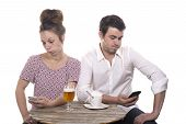 Young Couple With Their Phones Are Disgruntled poster