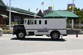 foto of armored car  - Armored truck parked to pick up money - JPG