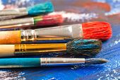 stock photo of arts crafts  - Oil paints and brushes to paint laid on the table in the composition Paints and brushes - JPG