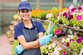 stock photo of greenhouse  - beautiful young small nursery business owner portrait in greenhouse - JPG