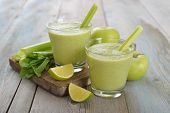 picture of celery  - Smoothie of green apple celery and lime on wooden background