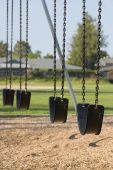 pic of swingset  - empty swings in a school yard playground - JPG