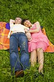 Couple Sleeping On Grass