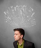 Young businessman thinking with sketched arrows in different directions above his head