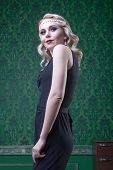 Blonde Woman Retro Style In Green Vintage Room
