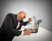 stock photo of reboot  - Concept of stress and frustration caused by a computer - JPG