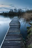 image of moonlit  - Beautiful tranquil moonlit landscape over lake and jetty - JPG