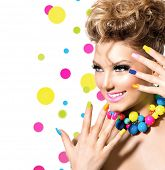 Beauty Girl Portrait with Colorful Makeup, Nail polish and Accessories. Studio Shot of Funny Woman.
