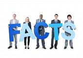 Multiethnic Business People Holding the Word Facts