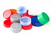 Colorful plastic caps isolated in white