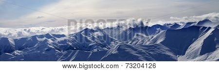 Panorama Of Evening Mountains In Clouds