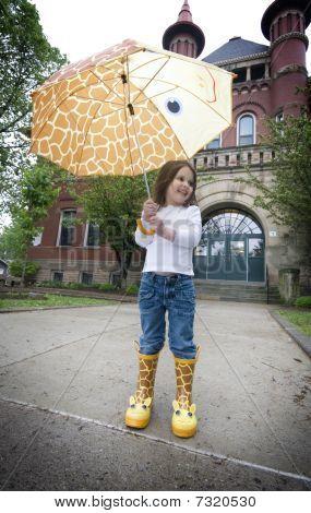 Rainy Day With Giraffe Umbrella And Galoshes