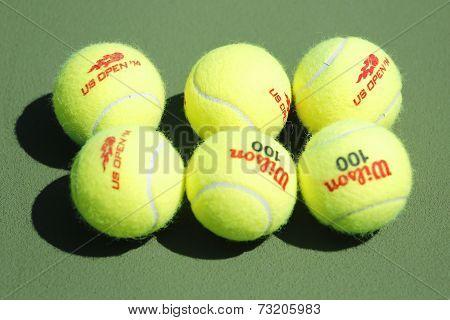 Wilson tennis balls on tennis court at Arthur Ashe Stadium
