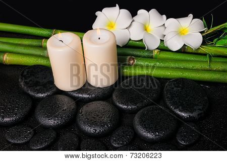 Spa Concept Of Zen Basalt Stones, Three White Flower Frangipani, Candles And Natural Bamboo With Dew