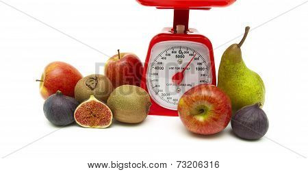 Fresh Fruit And Kitchen Scale On White Background
