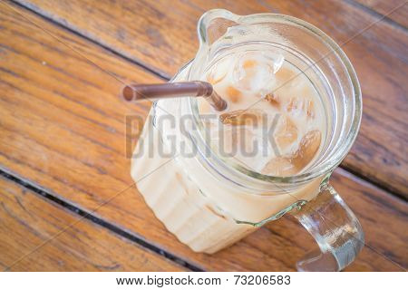 Close Up Fresh Iced Coffee Latte In Glass Pitcher