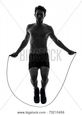 one  man exercising jumping rope in silhouette studio on white background