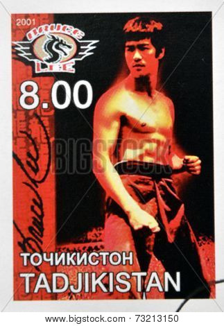 TAJIKISTAN - CIRCA 2001: stamp printed in Tajikistan shows Bruce Lee circa 2001