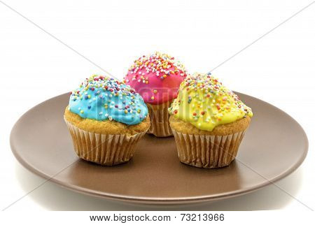 Cupcakes on plate on a white background