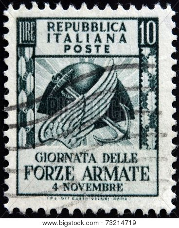 ITALY - CIRCA 1952: stamp printed in Italy shows Symbols of army navy and airforce circa 1952