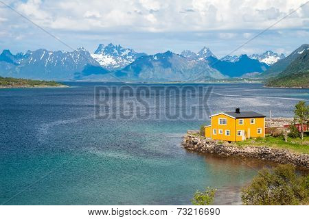scenic view of fjord, snow mountains and house, Norway, Lofoten
