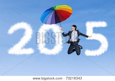 Businesswoman With Umbrella And Number 2015
