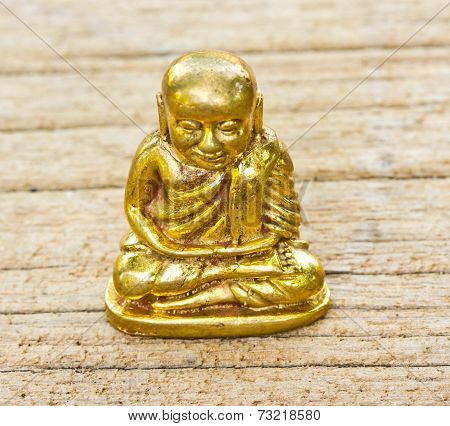 Small Buddha Image Used As Amulets On Wood Background