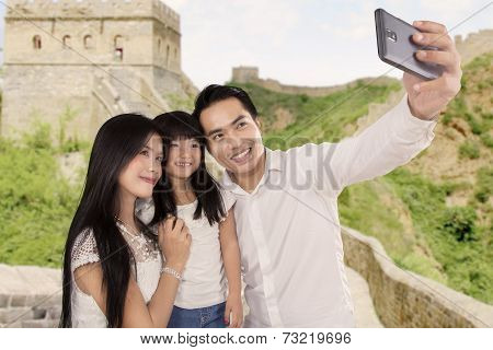 Happy Family Taking Photo In Great Wall