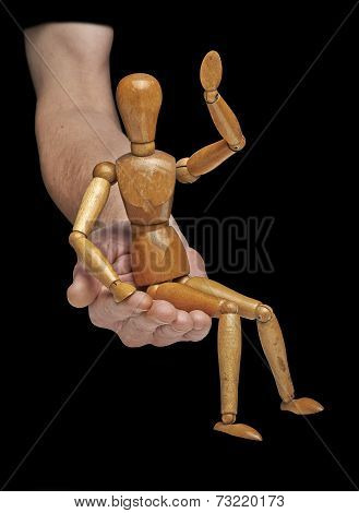 Wooden Dummy Say Hello And Is Sitting On A Helping Hand