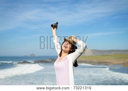 Happy Woman Enjoying Freedom Towards The Sea