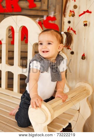 Smiling One Year Old Baby Girl Indoor