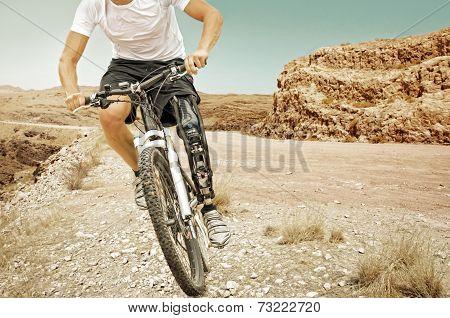 Handicapped Mountain Bike Rider Barren Landscape