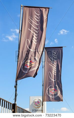 Samara, Russia - May 24, 2014: The Flags Of Cadillac Over Blue Sky. Cadillac Motor Car Division Is A