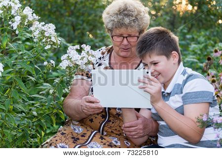 Grandma With  Grandson Watching Tablet Pc