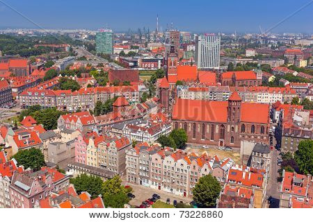 GDANSK, POLAND - 7 JULY 2014: People on the streets of the old town in Gdansk, Poland. Baroque architecture of the Gdansk is one of the most notable tourist attractions of the city.