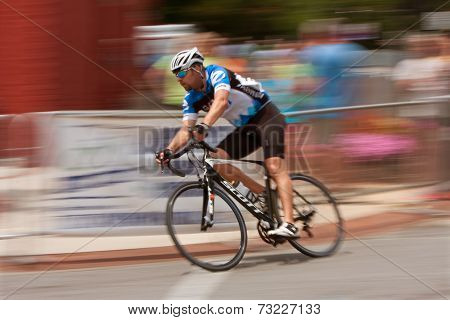 Motion Blur Of Cyclist Competing In Georgia Cup Criterium
