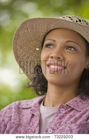 African American woman wearing straw hat
