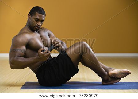 Bare-chested African man exercising