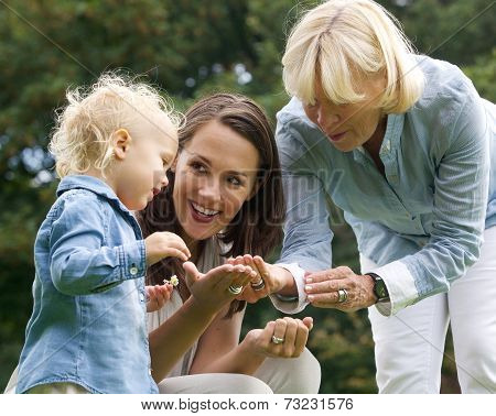 Happy Family With Baby Mother And Grandmother Outdoors