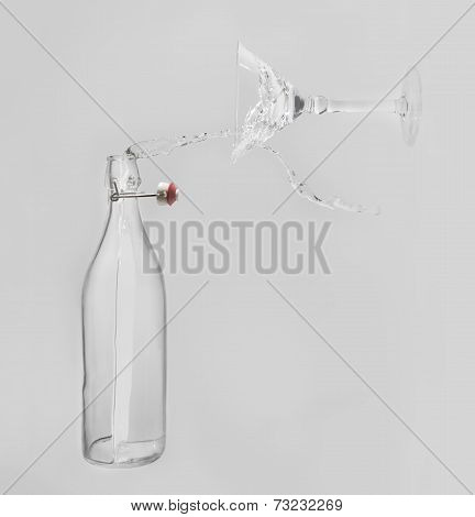 Clear Water Pour Horizontal Out Of Bottle Splash Into Glass With White Back Lighting