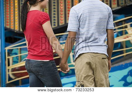 Multi-ethnic teenaged couple holding hands
