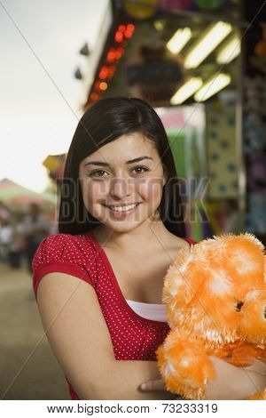 Mixed Race teenaged girl at carnival