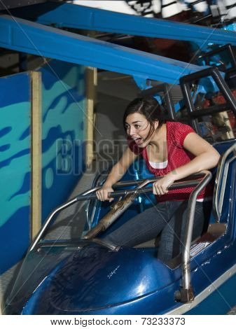 Mixed Race teenaged girl on carnival ride